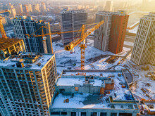 Building Crane On Construction Site Surrounded By New Real Estates