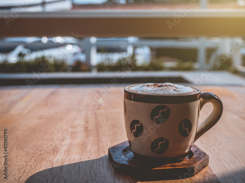 Close-up Of Coffee Cup On Table Fototapet