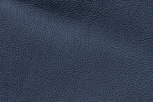 Dark Blue Color Genuine Cow Hide Leather. Texture Close-up. Fashionable Background