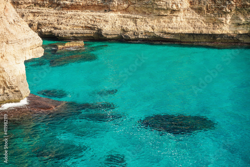 Clear blue green sea water, rocky cliffs around - nice sunny day at Ansa de s'Es Fototapet