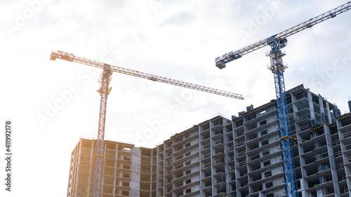 Tableau sur Toile Construction site with Construction crane and cloudy sky