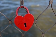 Close-up Of Heart Shape Love Lock Hanging On Fence