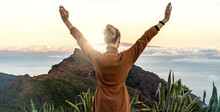 Traveling In Nature. Happy Woman Looking At The Beautiful Sunrise Landscape In The Mountains. Meditation Time.
