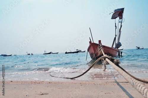 Canvastavla Fishing Boat Moored At Beach Against Sky
