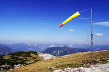 Windsock On Mountain Against Blue Sky