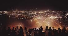 People Looking At Illuminated Cityscape