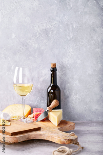 Wine With Cheese On Table Against Wall © roman larin/EyeEm