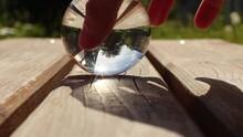 Sunlight Burns A Wooden Board Through The Spherical Lens