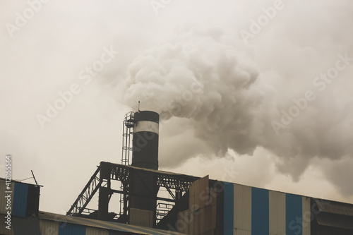 Canvastavla smoke coming out from the chimney of a factory industry