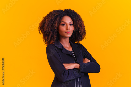 afro woman in pantsuit. Successful black woman, business woman.