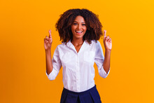 Afro Woman On Yellow Background With Fingers Crossed, Luck Concept