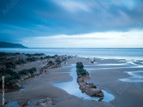Photo Scenic View Of Beach Against Sky