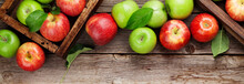 Green And Red Apples In Wooden Boxes