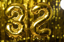 The Golden Number 32 Thirty Two Is Made From An Inflatable Balloon On A Yellow Background. One Of The Complete Set Of Numbers. Birthday, Anniversary, Date Concept