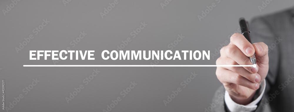 Fototapeta Man writes Effective Communication text in screen.