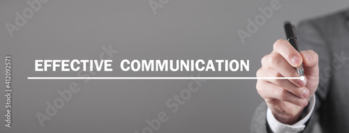 Obraz Man writes Effective Communication text in screen. - fototapety do salonu