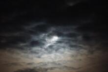 Full Moon Amidst Altocumulus Clouds