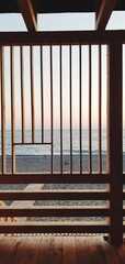 Wooden Railing By Sea Against Sky During Sunset
