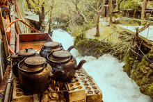 Closeup Of Old Kettles Near A River