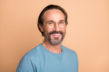 Photo Portrait Of Confident Man In Glasses Isolated On Pastel Beige Colored Background