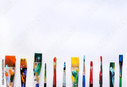 Fototapeta Directly Above Shot Of Multi Colored Paintbrushes Over White Background
