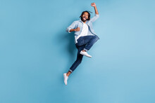 Full Length Body Size View Of Nice Cool Lucky Active Cheerful Guy Jumping Having Fun Isolated Over Bright Blue Color Background