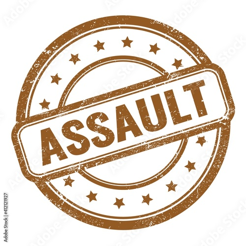 ASSAULT text on brown grungy vintage round stamp. Fototapet