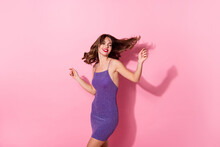 Photo Of Pretty Shiny Young Woman Dressed Violet Dress Smiling Dancing Isolated Pastel Pink Color Background