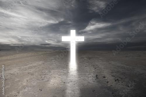 Obraz na plátne Christian Cross on the dry ground