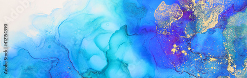 art photography of abstract fluid art painting with alcohol ink, blue and gold colors