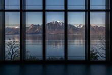 View Of Snow-capped Mountains Across Lake Geneva.