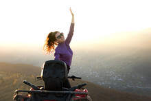 Young Happy Woman Enjoying Extreme Ride On Atv Quad Motorbike In Autumn Mountains At Sunset.