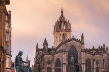 The Gothic Architecture Of St, Giles' Cathedral Against A Dramatic Sunset Or Sunrise Sky Along The Royal Mile In Edinburgh's Old Town.
