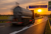 Tanker Truck Driving On The Highway At Sunset