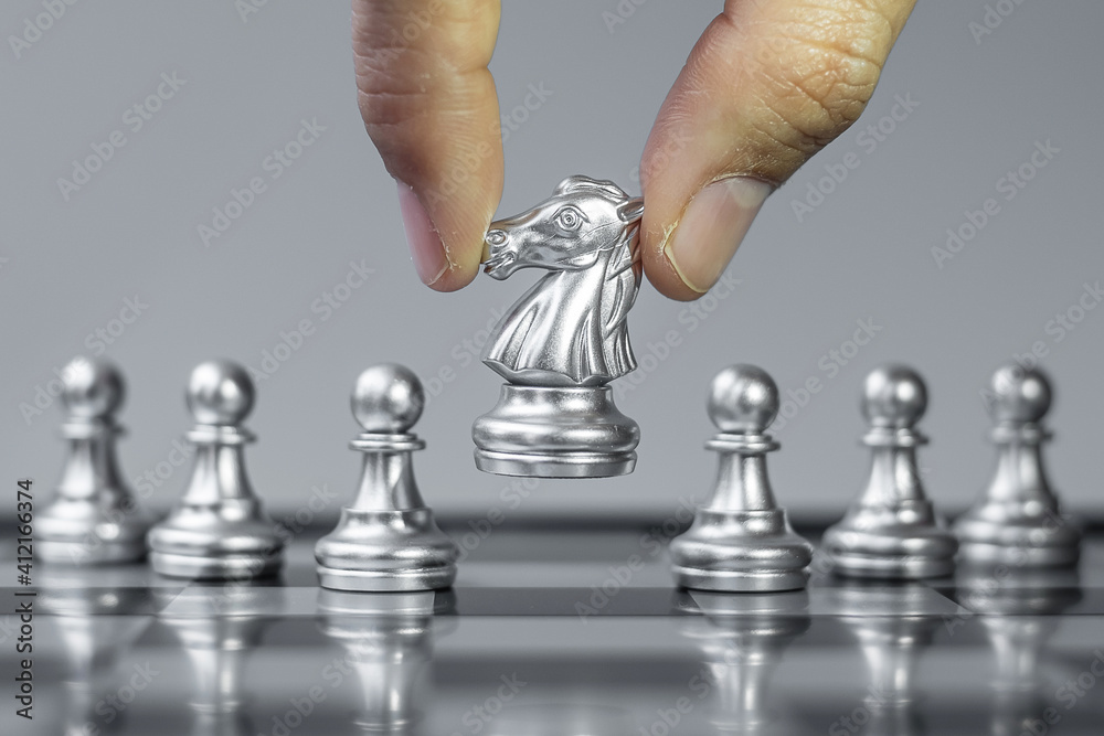 Fototapeta silver Chess knight figure Stand out from the crowd on Chessboard background. Strategy, leadership, business, teamwork, different, Unique and Human resource management concept