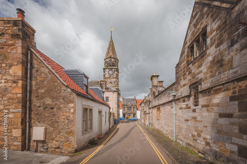 The quaint traditional village of Falkland, a popular filming location in Fife, Scotland on a sunny summer day Poster Mural XXL