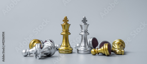 gold Chess king figure stand out from crowd of enermy or opponent during chessboard competition Tapéta, Fotótapéta