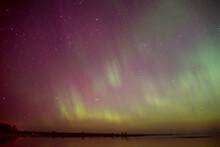 Intense Northern Lights (Aurora Borealis) Over Baltic Sea. Rocky Beach
