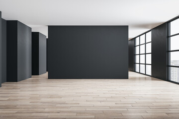 Concrete gallery interior with city view, daylight and blank gray wall.