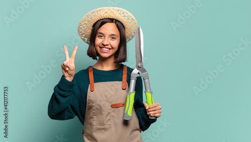 Fotografija young pretty woman. farmer concept
