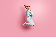 Full Length Photo Portrait Of Amazed Woman Jumping Up Isolated On Pastel Pink Colored Background