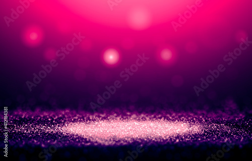 Purple and Pink sparkle rays glitter lights with bokeh elegant show on stage abstract background. Vintage background.