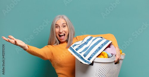 Obraz gray hair pretty housekeeper woman washing clothes - fototapety do salonu