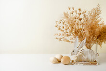 Rustic Easter Decorations With Wooden Rabbit, Eggs And Pampas Grass, Copy Space