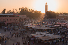 Overlooking The Historic Main Square Market Of Jemaa El-Fna In The Medina Of Marrakech, Morocco At Sunset.