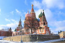 St. Basil's Cathedral And The Spasskaya Tower Of The Moscow Kremlin On Red Square