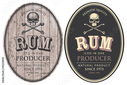 Fototapeta Set of two vector labels for Rum in oval frames with human skulls and crossbones on a wooden and black background in retro style. obraz