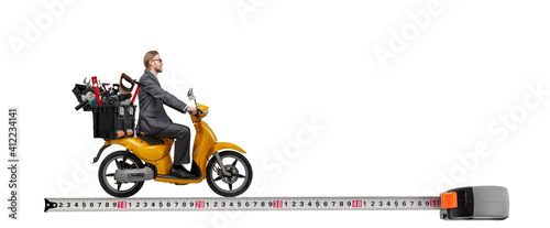 man on motor scooter bring construction tool - tape measure