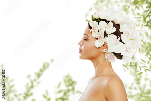 Woman Beauty Flowers Hair style. Fresh Smooth Skin and Healthy Hair Nature Care. Organic Green Leaves Whie Orchid Treatment