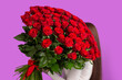 canvas print picture - The girl with big bouquet of flower roses on her shoulder